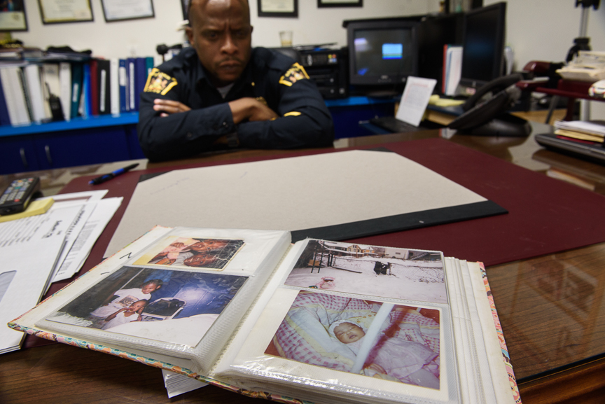 Rankin Police Chief Ryan Wooten sits in his office with a family album of photographs of Nyia Page on Jan. 25, 2018 in Rankin.