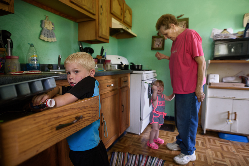 Cameron Gorman, 3, searches for a butterknife as his great-grandmother, Patricia Savulchak, 73, tends to his one-year-old sister, Layla, at her house on June 10, 2017 in Esplen, a neighborhood in Pittsburgh, Pa. Savulchak has kinship caregiver status over her great-grandchildren, after their mother died of an opioid overdose in March.