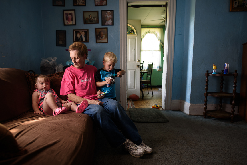 Patricia Savulchak, 73, sits with her great-grandchildren, one-year-old, Layla, and Cameron Gorman, 3, at her house on June 10, 2017 in Esplen, a neighborhood in Pittsburgh, Pa.