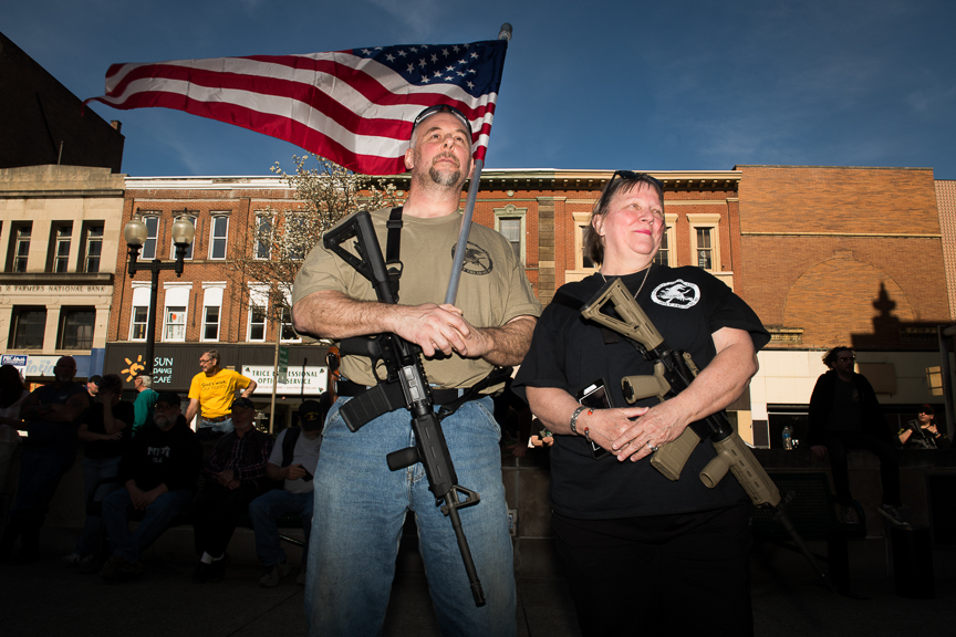 Bill Perkins of Gibsonia, Pa., stands with his wife, Marilyn Boulet, as they carry their AR-15 style rifles at a rally to support Martin Palla and gun rights on Sunday, April 22, 2018 in the courtyard of the Westmoreland County Courthouse in Greensburg, Pa. Palla, a Rostraver Township police officer, came under intense criticism when he stood across the street from the March 23rd March for Our Lives rally with an AR-15 style rifle.