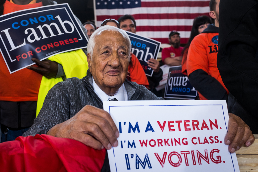 Johnny Bento, a longtime supporter of unions in Pittsburgh, listens to former Vice President Joe Biden speak at a rally for Conor Lamb, Democratic candidate for Pennsylvania's 18th Congressional District, at the Carpenters Training Center on Tuesday, March 6, 2018 in Collier Township, Pa.