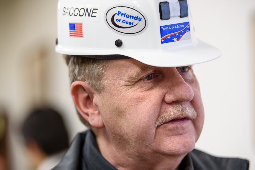 Rick Saccone wears a miner's helmet he was gifted as he talks with supporters at the VFW Post 4793 after a campaign rally on March 5, 2018 in Waynesburg, Pa.