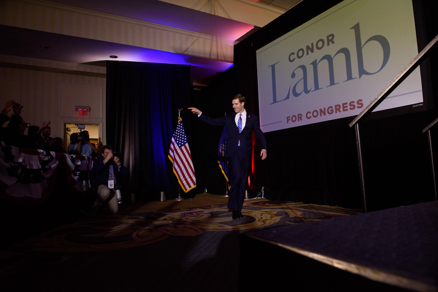 Conor Lamb, Democratic candidate for Pennsylvania's 18th congressional district, takes the stage to deliver his acceptance speech at his campaign headquarters at Hilton Garden hotel early Wednesday, March 14, 2018 in Southpointe, Pa.
