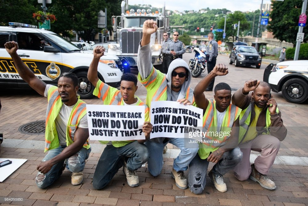 Construction workers walked off the job to join a protest a day after the funeral of Antwon Rose II on June 26, 2018 in Pittsburgh, Pennsylvania. Rose was killed by an East Pittsburgh police officer on Tuesday, June 19 when he fled on foot from a traffic stop and was shot three times in the back. Days of protest and unrest have continued in the wake of his death. (Photo by Justin Merriman/Getty Images)