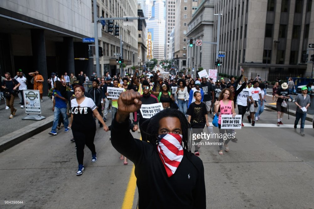 Trey Willis, 32, of Washington, Pa., marches during a protest a day after the funeral for Antwon Rose II on June 26, 2018 in Downtown, Pittsburgh, Pennsylvania. Rose was killed by an East Pittsburgh police officer on Tuesday, June 19 when he fled on foot from a traffic stop and was shot three times in the back. Days of protest and unrest have continued in the wake of his death. (Photo by Justin Merriman/Getty Images)