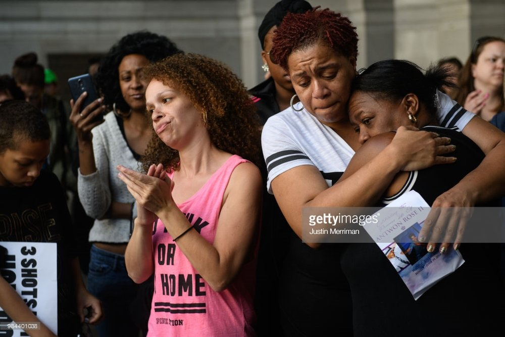 Family of Antwon Rose II embrace as they listen to speakers during a protest calling for justice for the 17-year-old on June 26, 2018 in Downtown, Pittsburgh, Pennsylvania. Rose was killed by an East Pittsburgh police officer on Tuesday, June 19 when he fled on foot from a traffic stop and was shot three times in the back. Days of protest and unrest have continued in the wake of his death. (Photo by Justin Merriman/Getty Images)