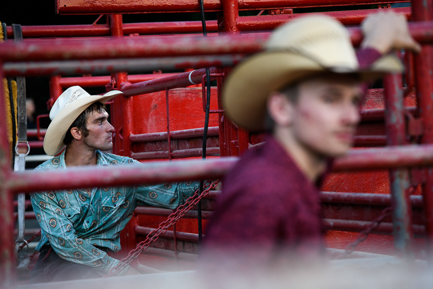 Cowboys stand in the pens as they watch the Fort Armstrong Championship Rodeo on Friday, July 13, 2018 at the Crooked Creek Horse Park in Ford City, Pa.