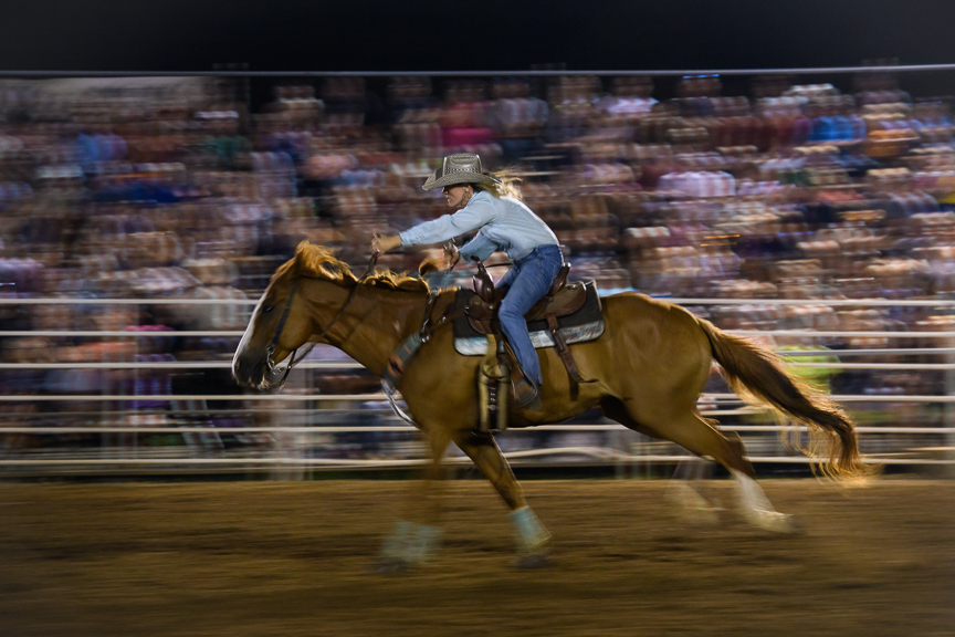 A rider competes in the barrel racing competition during the Fort Armstrong Championship Rodeo on Friday, July 13, 2018 at the Crooked Creek Horse Park in Ford City, Pa.
