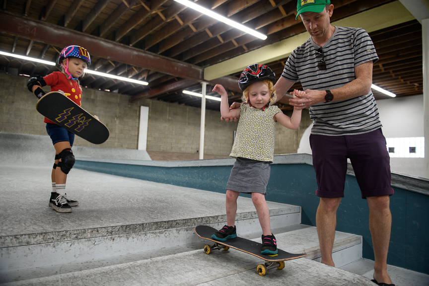 Frankie Wolber of Edgewood, Pa., left, watches Ryan Eckel, of Point Breeze, Pa., help his daughter, Sage, 3, skate at Switch and Signal Skatepark on Sept. 1, 2018 in Swissvale, Pa.