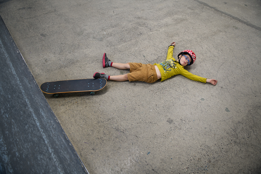 Desmond Henry, 6, of East Liberty, Pa., takes an awkward break from skating at Switch and Signal Skatepark on Sept. 1, 2018 in Swissvale, Pa.