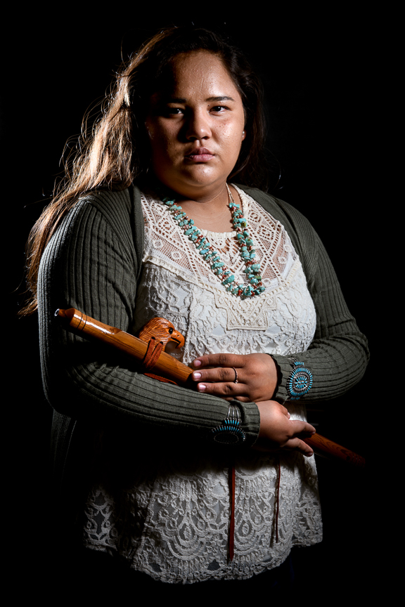 "Esperanzo Lee, 16, holds her Navajo flute, as she is photographed at San Juan High School on October 2, 2018 in Blanding, Utah. ""It's a good thing to keep our culture and language alive. It's something we need to keep going for our youth. It brings happiness to our elders that we can share and show our culture is still here,"" says Lee."