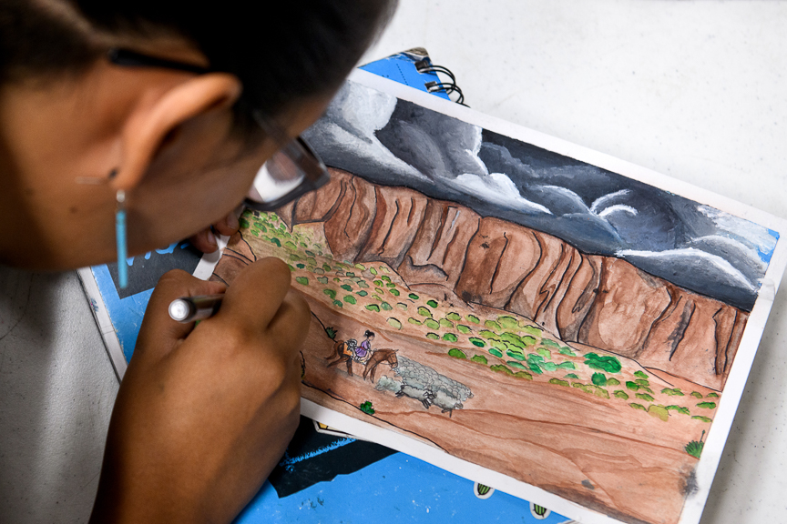 Syiera Tsosie, 14, works on a painting as she takes a break from working on the development of Duolingo's Navajo language course at San Juan High School on October 1, 2018 in Blanding, Utah.