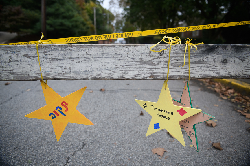 Items hang from a police roadblock near the Tree of Life Synagogue.