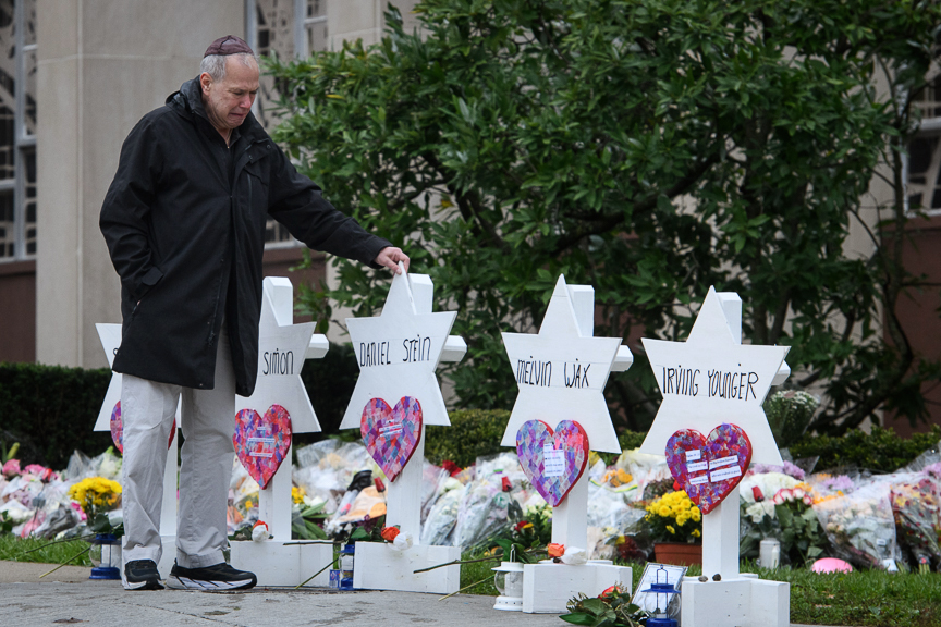 Bob Goldstein, 71, of Squirrel Hill walks past memorials in front of the Tree of Life Synagogue on Monday, October 29, 2018. Goldstein has attended the Tree of Life for his entire life and knew 8 of the victims.