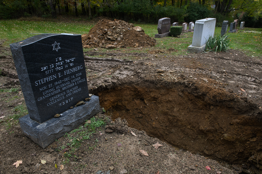 A freshly dug grave sits open at the Tree of Life Memorial Park on Monday afternoon, October 29, 2018 in Pittsburgh's North Hills.