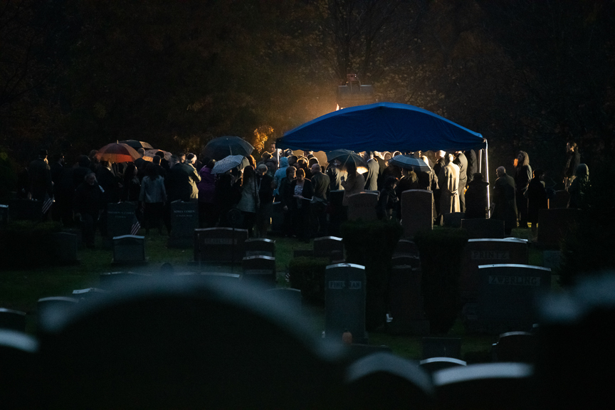 Mourners gather around the gravesite of Richard Gottfried during his burial service at New Light Cemetery on Thursday, November 1, 2018 in Etna, Pa.