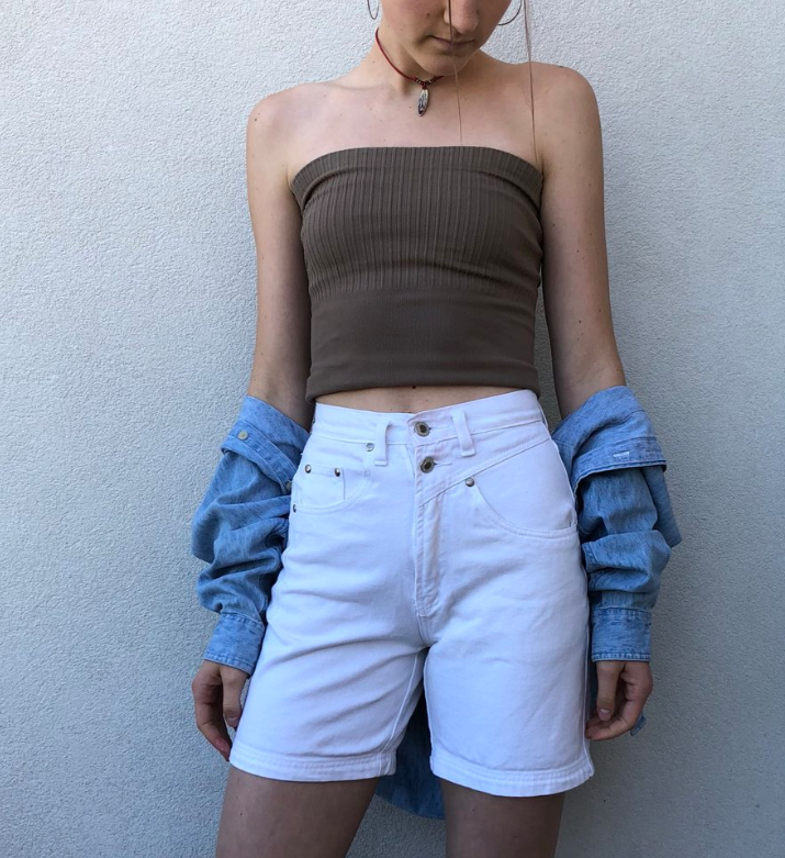 Freshman Alida Sumich (IA)  Alida rocks a pair of white denim yacht shorts she thrifted from a shop in central California. She paired her shorts with a brown ribbed tube top finishing off with an oversized jean jacket.