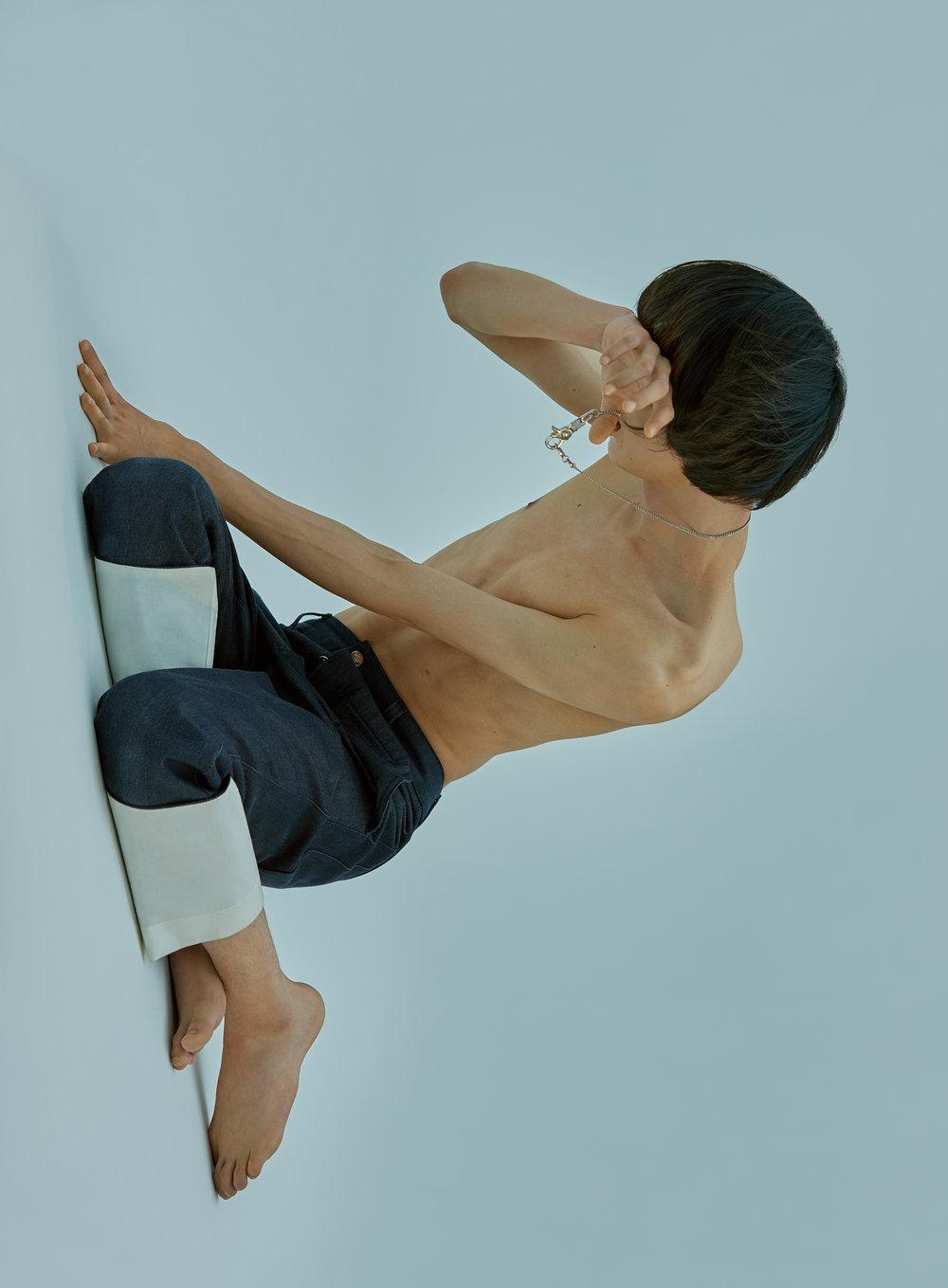 Denim Trousers: Loewe  Necklace: H.R