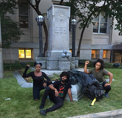 Organizers from BYP100 after the monument was torn down. D'atra Jackson (left) will be a trainer at POC Momentum in October.