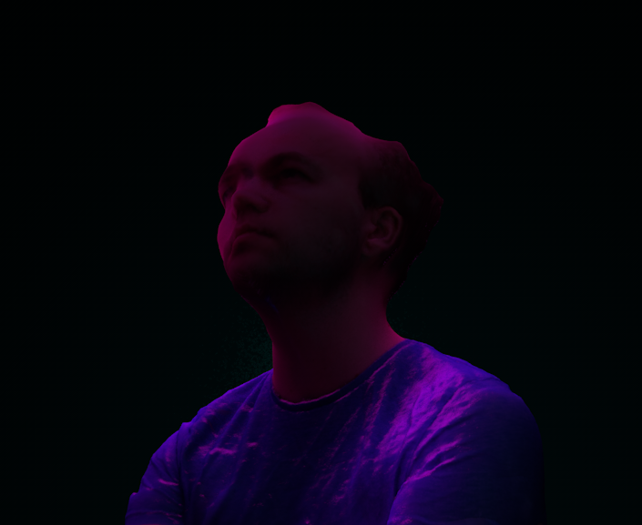My head, captured using photogrammetry, and lit with neon style lighting.