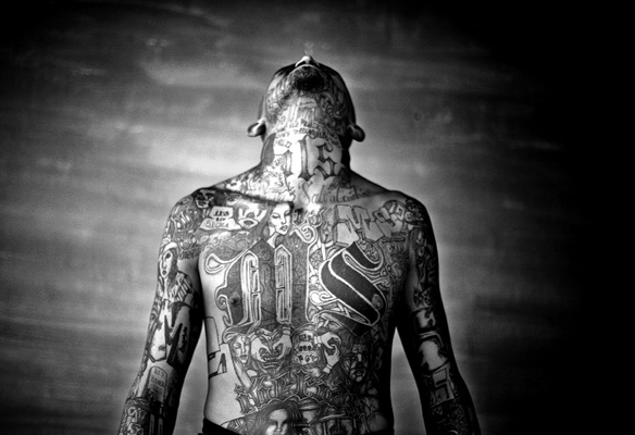 A member of the Mara Salvatrucha gang displays his tattoos inside the Chelatenango prision in El Salvador. Photo by Moisen Saman, courtesy of Sony World Photograpy Award 2008