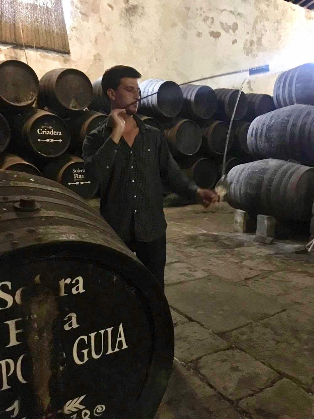 Jack tasting wine out of the barrel at Bodega Gutierrez-Colosia in El Puerto de Santa Maria, Spain. He was there to meet the family behind the winery and vet the wines for his wine bar in Charleston, South Carolina.