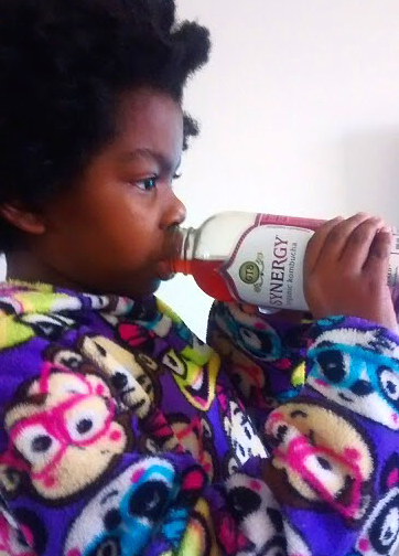 Desiraye, 7, enjoys her daily serving of kombucha. Photo courtesy of Demetria Cox-Thomas.