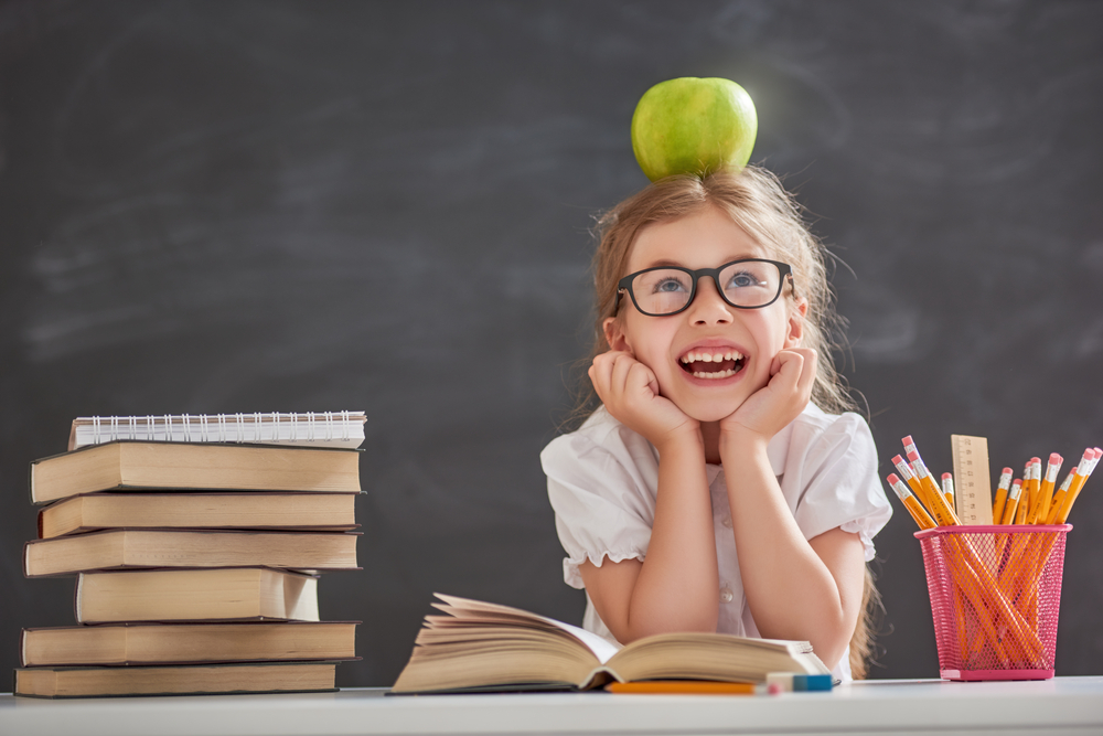 girl back to school apple top of head.jpg