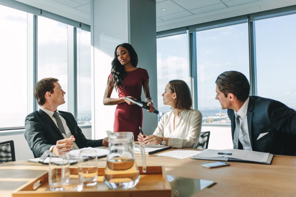 woman board business meeting shutterstock.jpg
