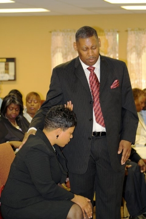 First Lady Praying For Pastor.jpg