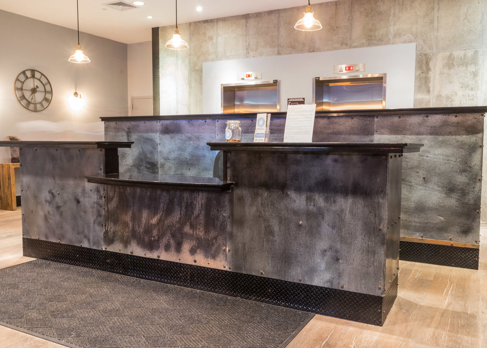 Acid-Washed Zinc Reception Desk and Wall