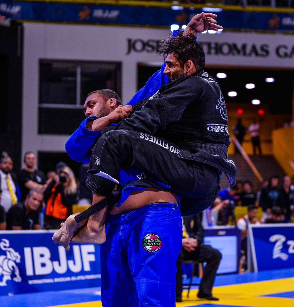 Here we have Leandro Lo taking the back of Victor Honório. I had never seen Victor fight before and was told he doesn't often come to compete in the USA. He is a beast. Lo was losing this match, but in the closing seconds pulled this move and secured his place to move on in the Open Class Final.