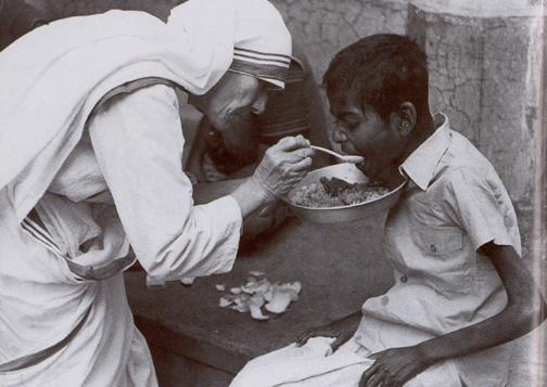 St. Theresa of Calcutta feeding a hungry child