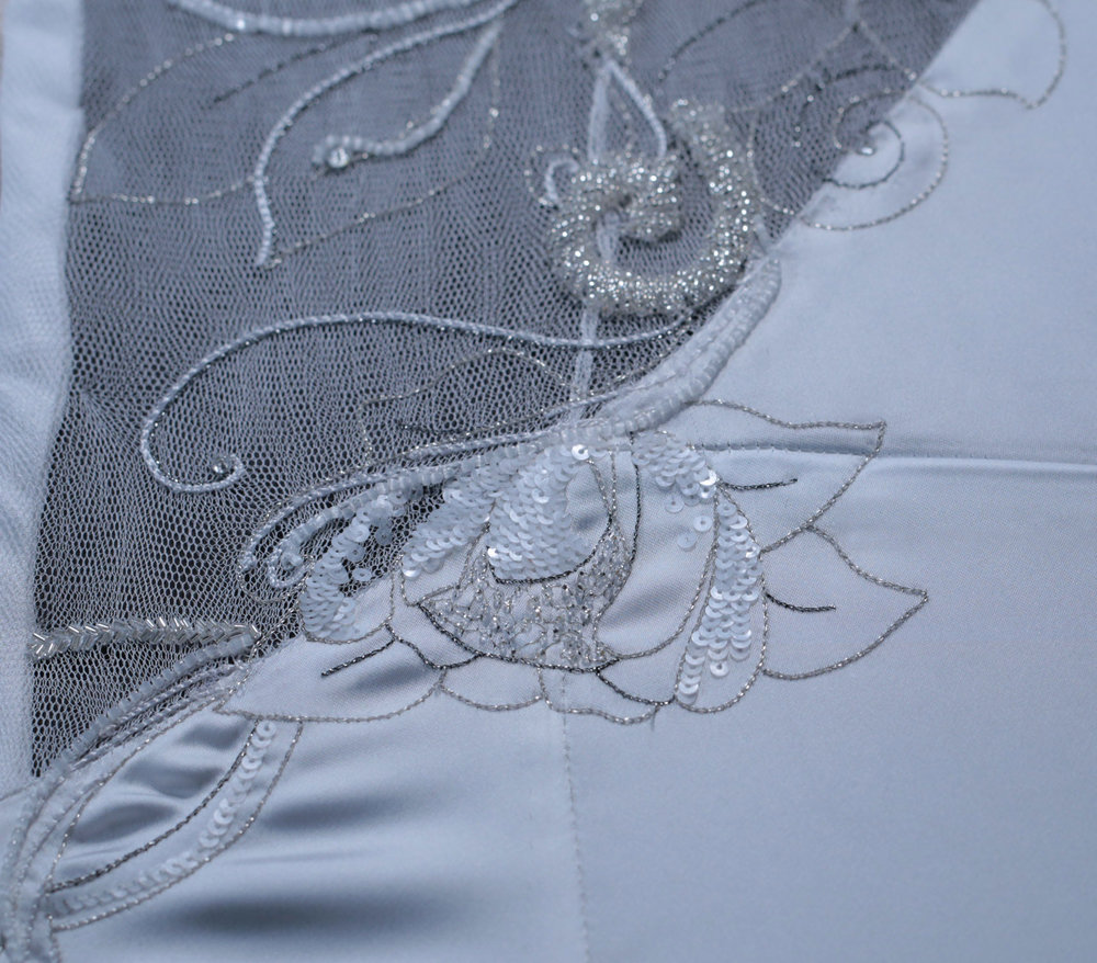 Handmade tambour embroidery with metallic thread, sequins and beads.