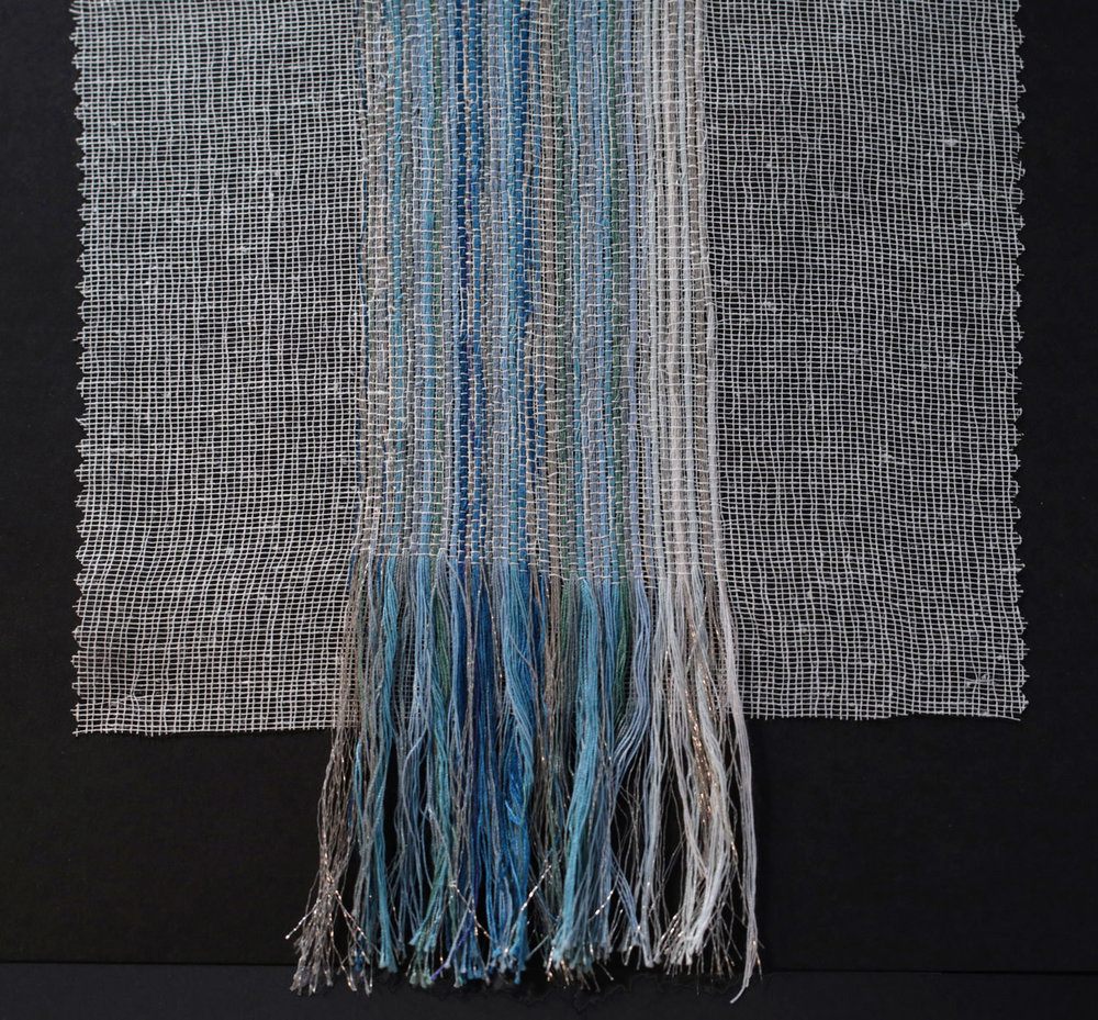 Handwoven threads throughout large canvas.