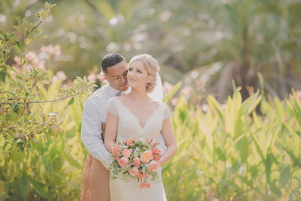 tender groom kiss in pretty light {Auckland wedding photographer}