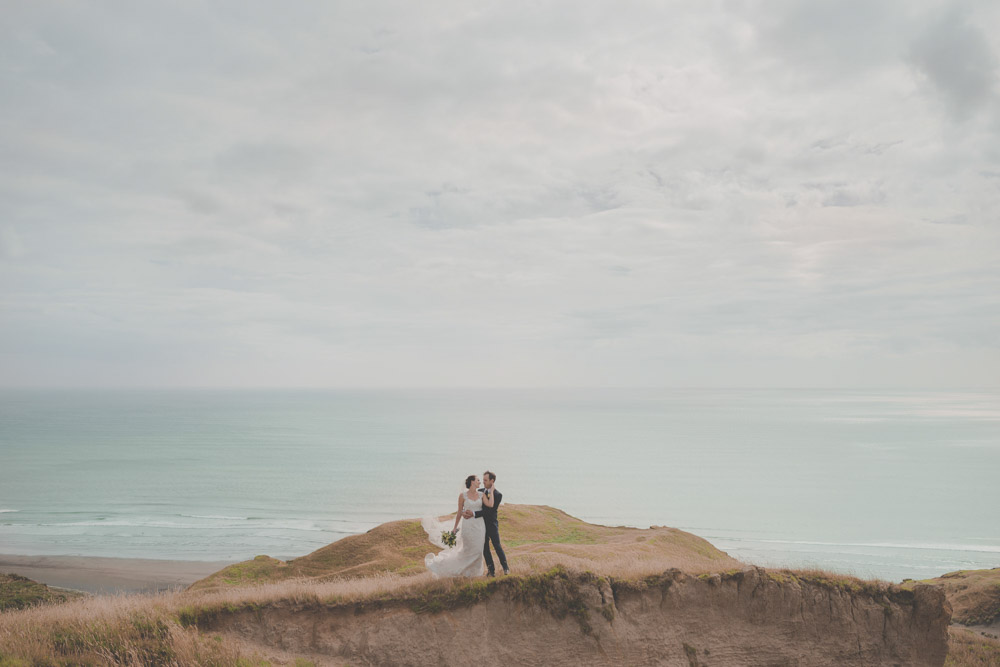 couple standing on rocks {New Zealand wedding photographer}