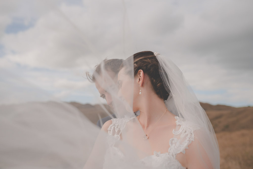 couple under the veil (Castaways - Auckland wedding photographer}