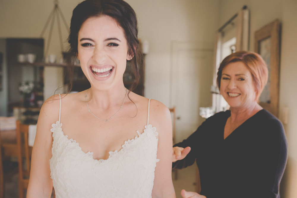 bride laughing - getting ready