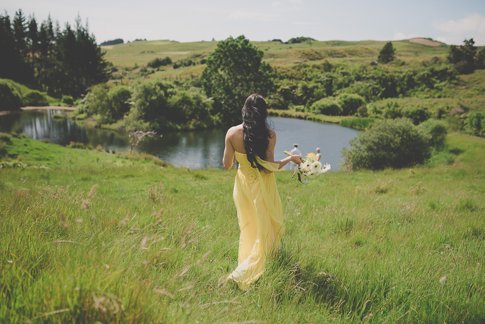bridesmaid walking on the field {New Zealand wedding planning and inspiration} bridesmaid dress
