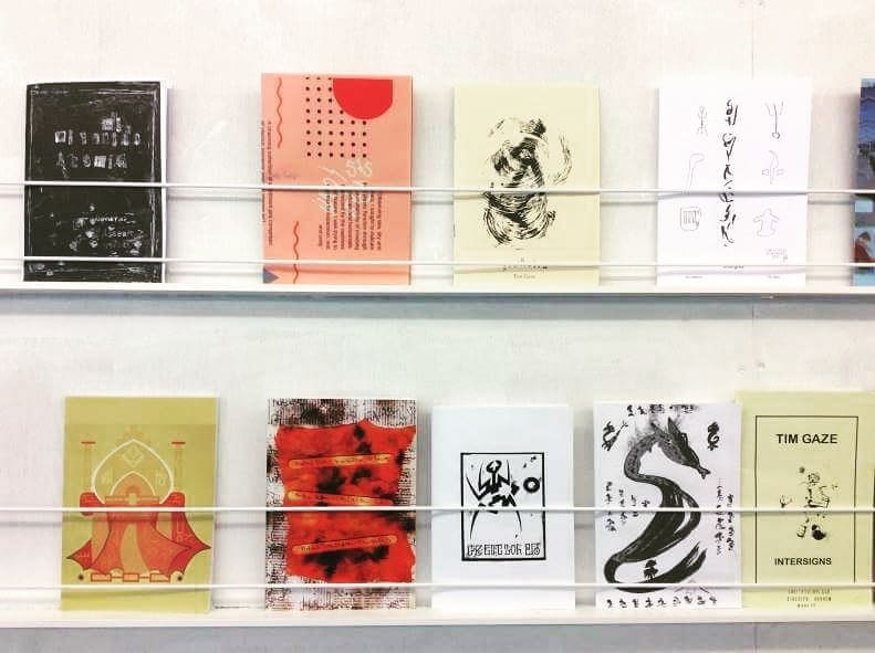 - PARASITIC ZINE GATHERINGARHEM, THE NETHERLANDSMy zines featured on the top shelf! Second from the left.