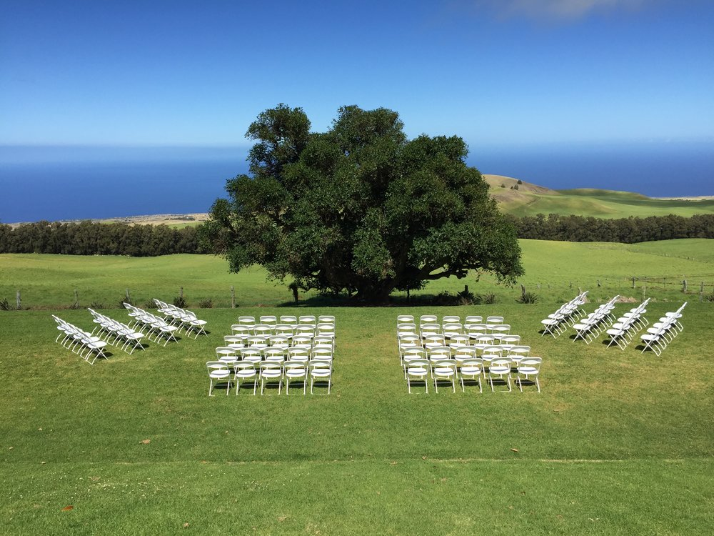 White Plastic Folding Chairs for ceremony at  Kahua Ranch .