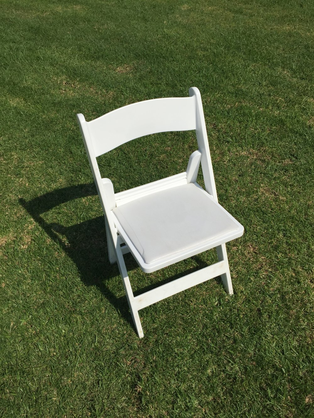 "White Padded Resin Folding Chairs  Dimensions: 19"" wide x 17"" deep x 30"" tall"