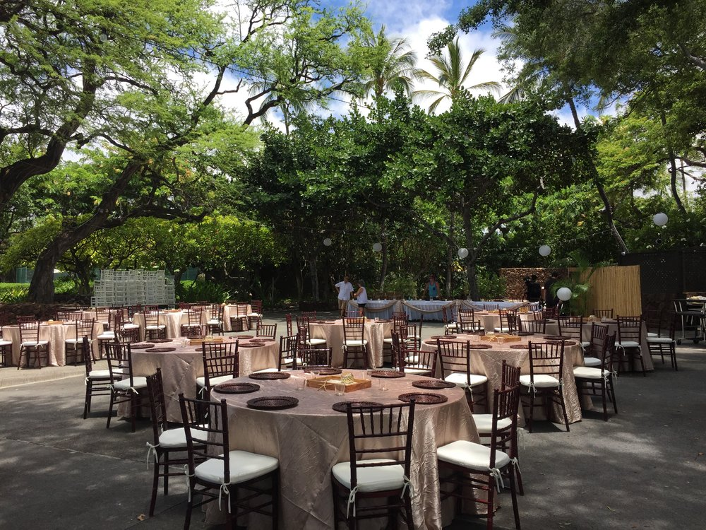 Mahogany Chiavari Chairs with Ivory Cushions for a wedding at  Mauna Kea Beach Hotel  North Point Luau Grounds.