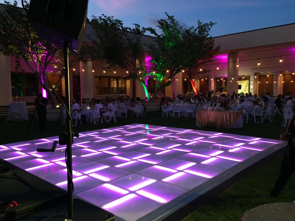 LED Lighted Dance Floor for a wedding at the Courtyard at the beautiful Hapuna Beach Hotel.