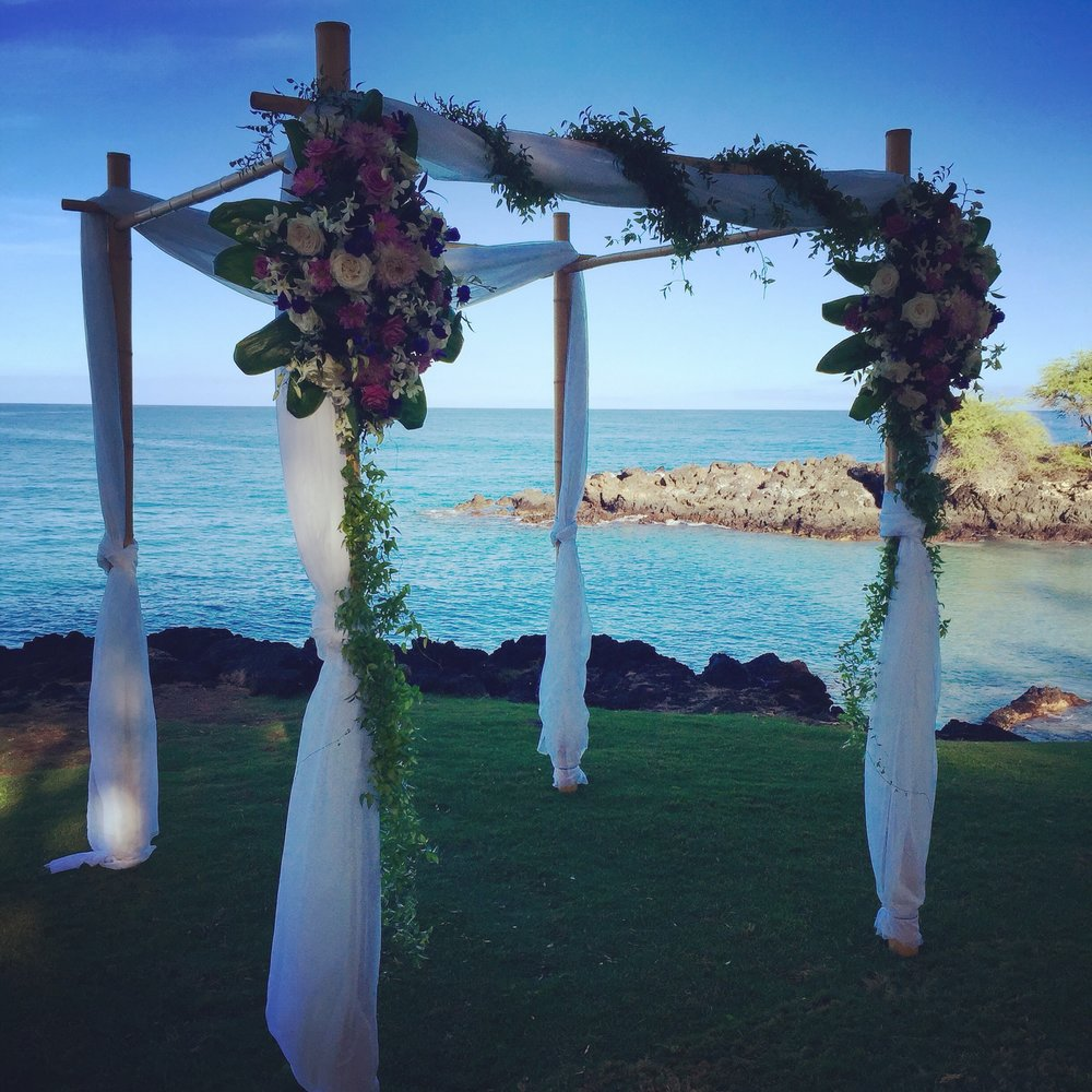 Bamboo Wedding Structure with simple fabric for ceremony at Hapuna Beach Hotels Turtle Point lawn.  Florals by Ainahua Florals.