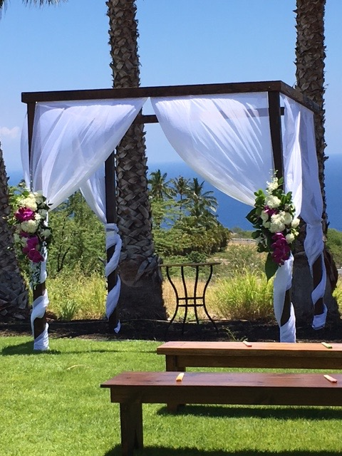 Dark Wood Wedding Structure with full fabric draping paired with our Dark Wood Benches for ceremony In Kohala View Estates.  Floral by Nicco.