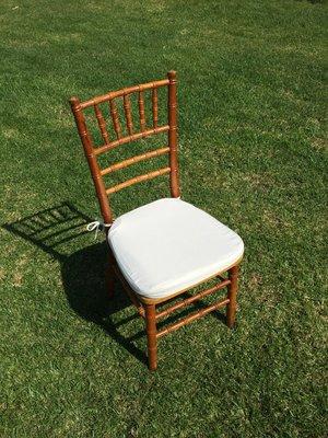 """Natural Chiavari Chair with Ivory Cushion  Dimensions: 19"""" wide x 17"""" deep x 30"""" tall"""