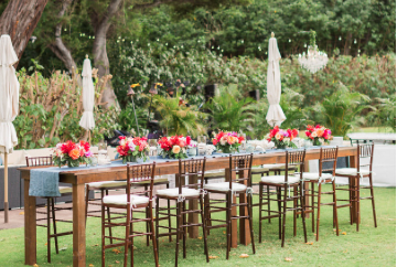 "Farm Tables with long legs to make ""pub tables"", paired with Dark Wood Barstool Chiavari Chairs.   Photo  Sea Light Studios  
