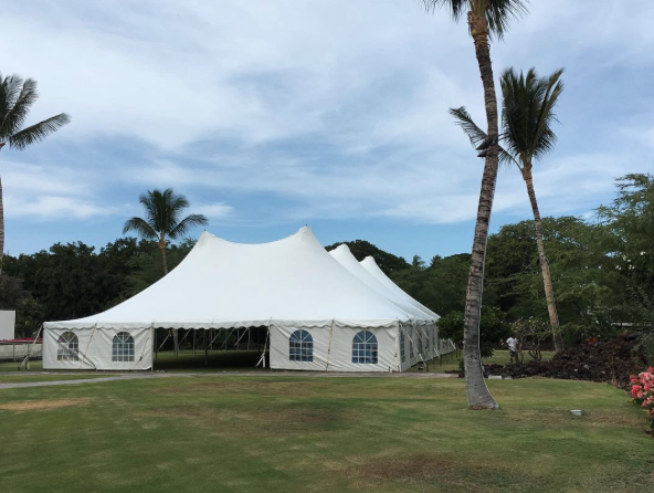 60x100 pole tent with Cathedral Windowed Side Curtains for corporate event at  Mauna lani bay hotel .